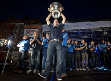 Welcome home: Dubs skipper Stephen Cluxton shows off Sam Maguire at last night's homecoming in the capital.