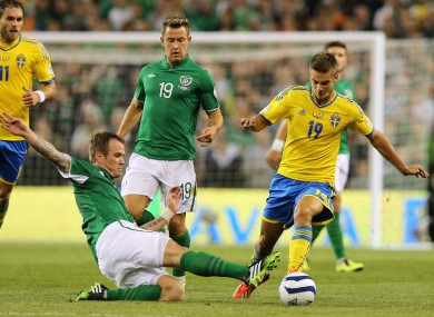 Ireland's Glenn Whelan and Alexander Kacaniklic of Sweden.