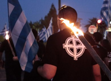 A supporter of Golden Dawn takes part in a march in Athens.