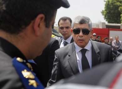 Egyptian Interior Minister Mohammed Ibrahim, right,