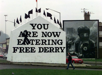 Black flags for each of the victims of Bloody Sunday fly over Free Derry Corner in Derry, 1998.