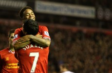 Suarez plays down Liverpool title hopes, sets sights on Champions League spot
